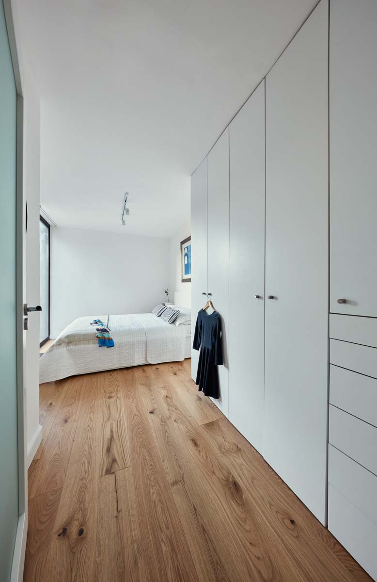 Small apartment restoration with contemporary storage solutions